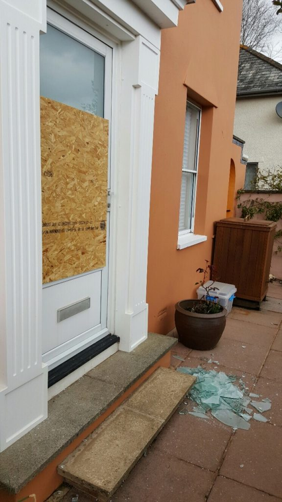 Avril's door after the police forced entry